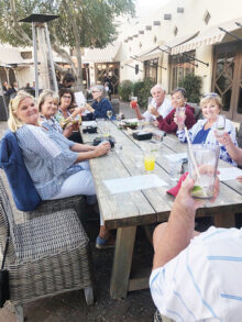 Members of the PebbleCreek Singles Club enjoying happy hour on the patio at the Wigwam Resort.
