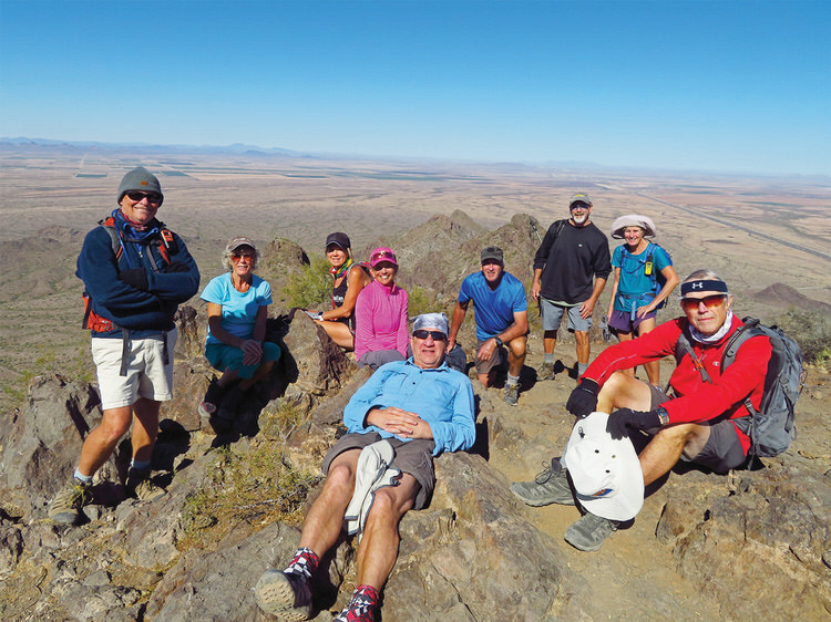 From left: Neal Wring, Vicki Carter, Kris Raczkiewicz, Marilyn Reynolds, Bill Halte, Clare Bangs, Leon and Eileen Mosse, and Lynn Warren (photographer) relaxing after a leisurely lunch on the summit of Picacho Peak.