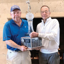 John McCahan (right) presents the club championship trophy to Jack Schafer