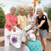 Singles Club members: June Proznik, Jan Hansen, President Judy Maloney, and Carolyn Bates