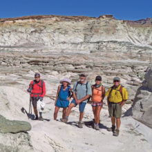 Left to right: Lynn Warren (photographer), Eileen and Leon Mosse, Kris Raczkiewicz, and Neal Wring enjoying a magical canyon with brilliant white rock formations in southern Utah.