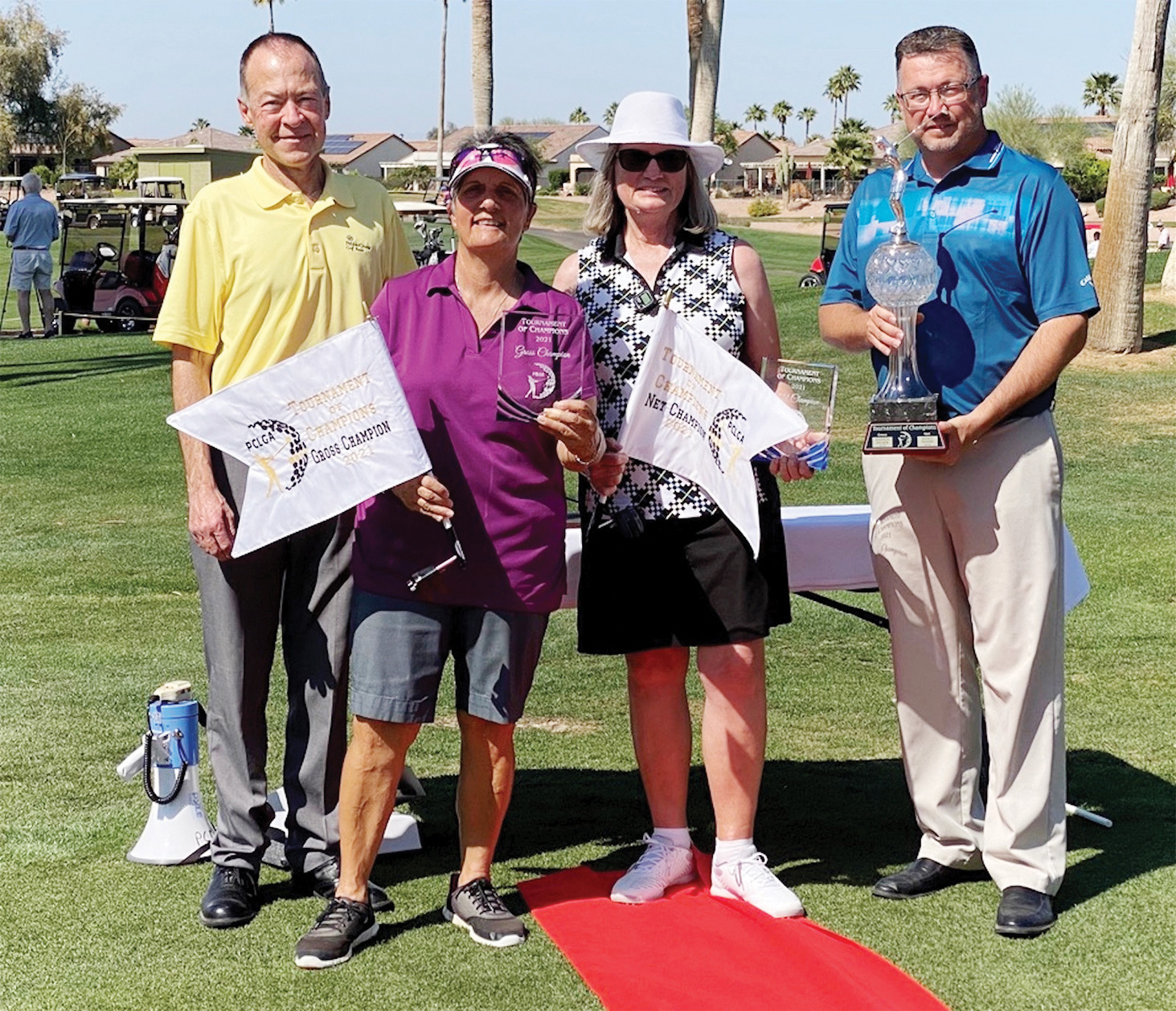 Left to right: Head Pro John McCahan, Gross Champion Andrea Dilger, Net Champion Diana Hull, and Pro Ronnie Decker