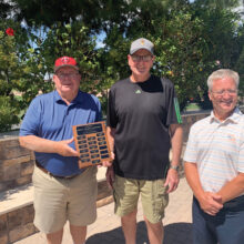 Bill Lansing, PCM9GA director of golf operations, presents the 2021 Men's 9 Holers Low Gross Champion plaque to Fred Schmidt with Tuscany pro David Vader