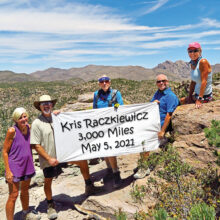 Left to right: Eileen and Leon Mosse, Lynn Warren (photographer), Neal Wring and Kris Raczkiewicz pause on Inspiration Point (with Cochise Head in the background) in the Chiricahuas to celebrate Kris' achievement.