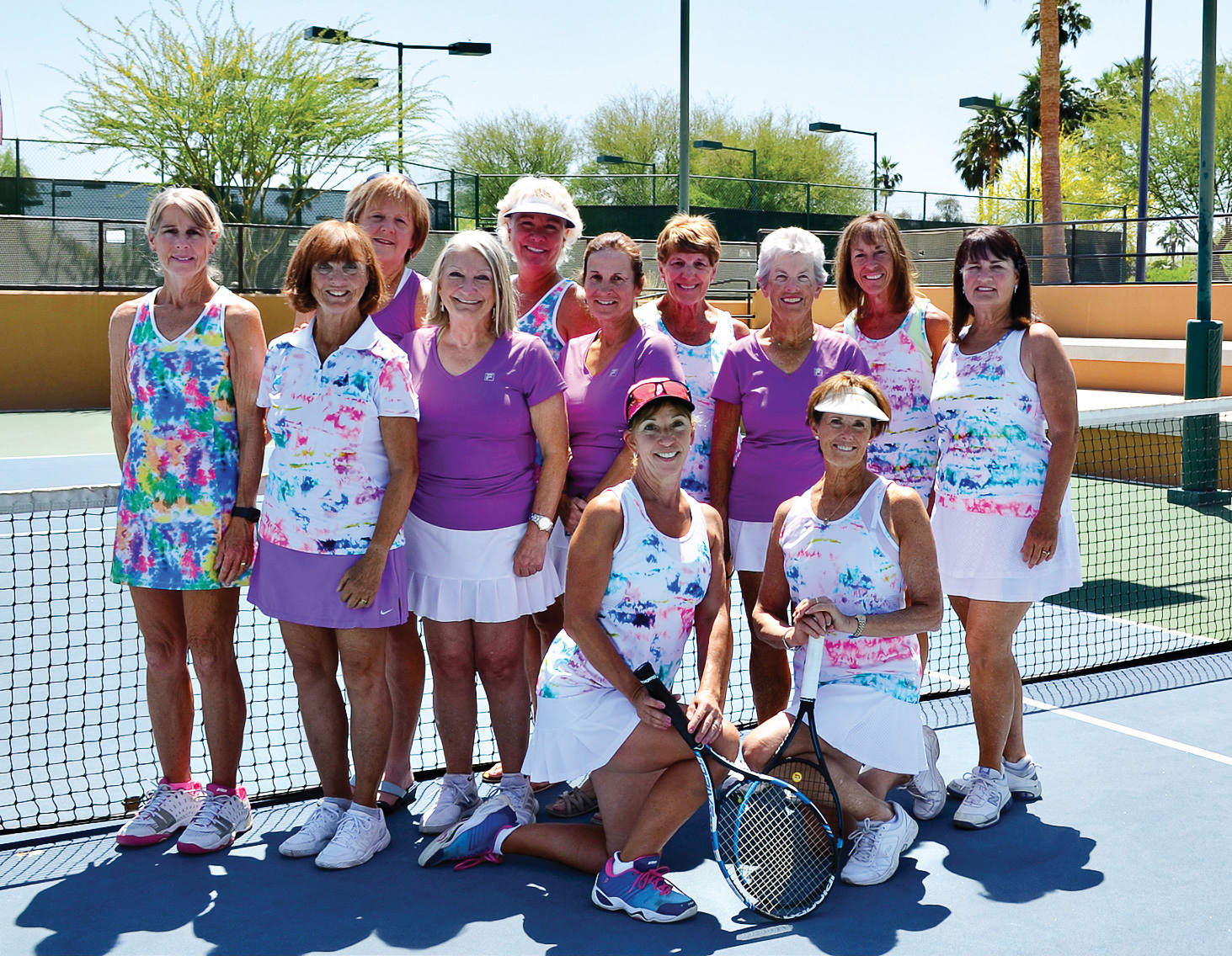 Passion's team members, kneeling (left to right): Joan Patchin and Lynne Carlyle; second row: Vikki Constable, Karyn Swinford, Cindy Henry, Barbara Camozzi, Pat Owens, and Pat Ingalls; back row: Lorinne Banister, Kathy Carver, Cooky O'Brien, and Debbie Welsh; missing from picture: Myrna Bodner, Brenda Cook, Sara Foster, Karen Kattar, and Jill Santy