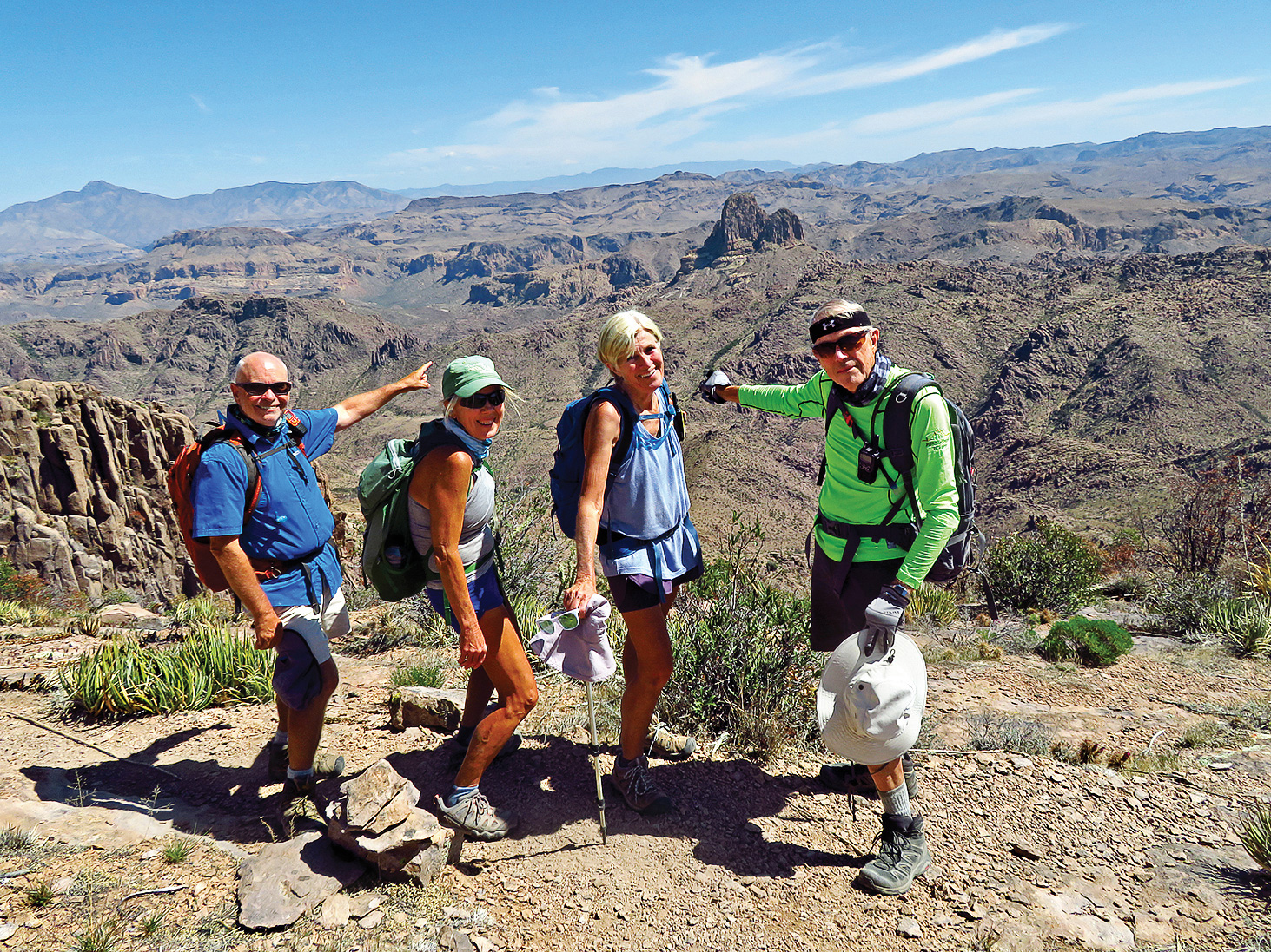 Left to right: Neal Wring, Kris Raczkiewicz, Eileen Lords-Mosse, and Lynn Warren (photographer) pausing near the base of Superstition Peak with Weaver's Needle far below.